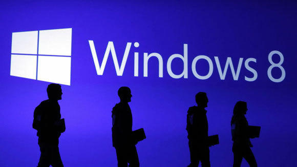 Guests are silhouetted at the launch event of Windows 8 operating system in New York last October.