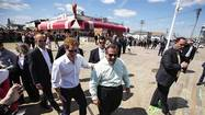 Britain's Prince Harry walks with New Jersey Governor Christie as they view areas of the boardwalk that have been repaired in Seaside Heights after Hurricane Sandy in New Jersey