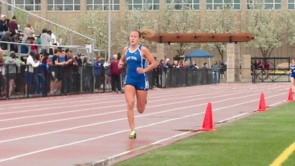 Jessica Ackerman cometing in the 3,200 meter race at Loyola