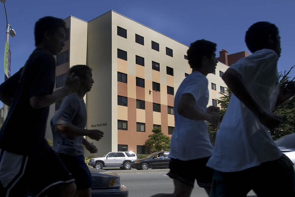 A group of athletes runs past Mary Park Hall at San Francisco State University (Robert Durell/Los Angeles Times)