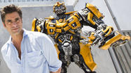 Actor John Stamos with Optimus Prime and Bumblebee at Universal Studios