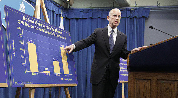 Gov. Jerry Brown points to a chart showing an increase in education funding in his proposed 2013-14 state budget during a January news conference.