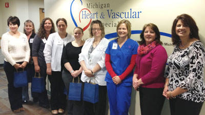 Michigan Heart & Vascular Specialists of McLaren Northern Michigans team for the Win by Losing competition is paid a visit by Blue Cross Blue Shield representatives after taking top local honors in the weight-loss competition this year. Pictured are (from left) team members Michelle Watson, Laura Medsker, Teresa Eberly, Sara Petrowski, Ashley Westover, Sandy ONeill and Krista Cook, and Blue Cross Blue Shield representatives Donna Ludwig and Lynne Harvey. Absent from the photo are Michigan Heart & Vascular Specialsits team members Sarah Herron and Melanie Bingham.