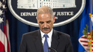 WASHINGTON — Atty. Gen. Eric H. Holder Jr. strongly defended the far-reaching probe in the disclosure of security information by the Associated Press and said American lives were jeopardized when the wire service revealed details of a foiled plot to detonate a bomb on a U.S.-bound airplane last year.