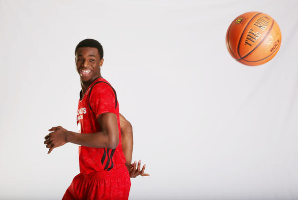 McDonald's All American forward Andrew Wiggins poses for portraits before the 36th McDonalds All American Game in Chicago. Wiggins will play for the Kansasy Jayhawks next year he announced Tuesday.