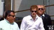 Britain's Prince Harry expressed astonishment at the damage still evident on the New Jersey shore from Hurricane Sandy on Tuesday as he toured hard-hit towns and took in the view of the historic Seaside Heights roller coaster, which was washed into the sea during the storm.
