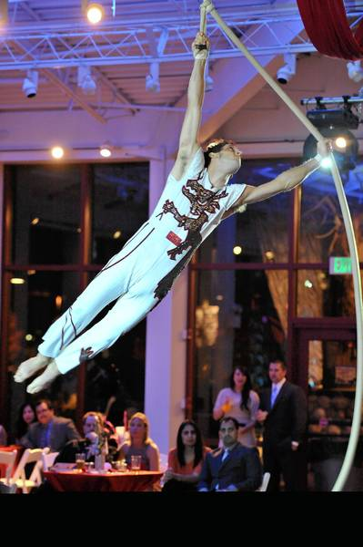 A performer gets airborne last year at the Bolingbrook Hospital Foundation's symphony gala.