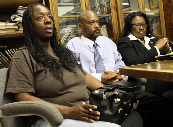 Anya Slaughter, left, and Kenneth McDade, parents of Kendrec McDade, speak to reporters in 2012, accompanied by attorney Caree Harper.