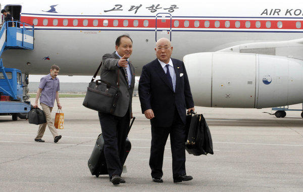 Isao Iijima, right, a top advisor to Japan's prime minister, arrives in Pyongyang, North Korea, on Tuesday for an unannounced visit.