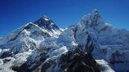 A warming climate is melting the glaciers of Mount Everest, shrinking the frozen cloak of Earth's highest peak by 13% in the last 50 years, researchers have found.