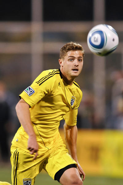 Robbie Rogers wants to play for the Galaxy, but his rights are held by the Fire.