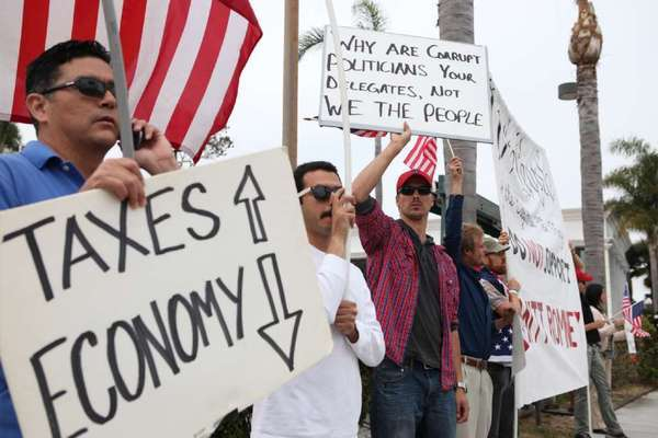 "The IRS is under fire for giving extra scrutiny to applications for tax-exempt status from grass-roots conservative groups. Above, ""tea party"" demonstrators  last June in Newport Beach."