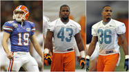 The Miami Dolphins have signed three of nine players selected in the 2013 draft.