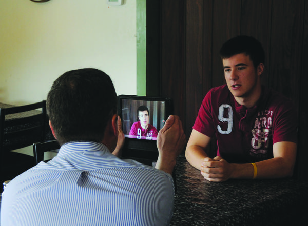 Conemaugh Township student Matthew Phillippi does a video interview with Daily American Editor Brian Whipkey.