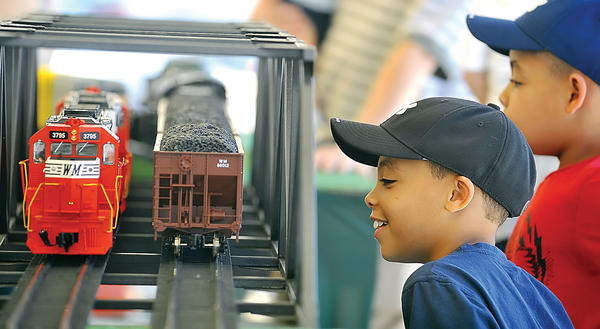 Noah and Nicholas Milum, age 7 of Hagerstown watch G scale model trains go by at the Hagerstown Roundhouse Museum, at last year's Railroad Heritage Days. This year's event is Saturday, May 18, and Sunday, May 19.