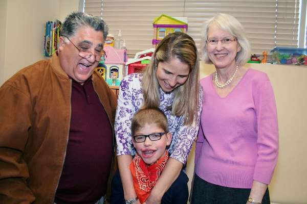 Former Assemblyman Anthony Portantino joins, from left, Susan Andres, her son Adam Andres, 12, and Diane Cullihane, executive director of the Pasadena Child Development Associates.
