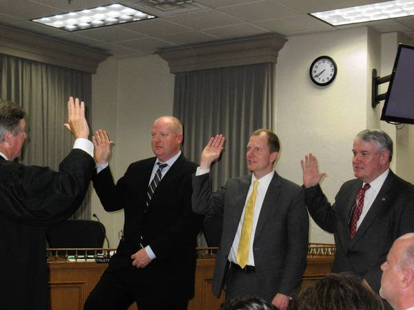Timothy O'Shea, Timothy Elliott and Dean Clark were sworn in as Glen Ellyn trustees on May 13.