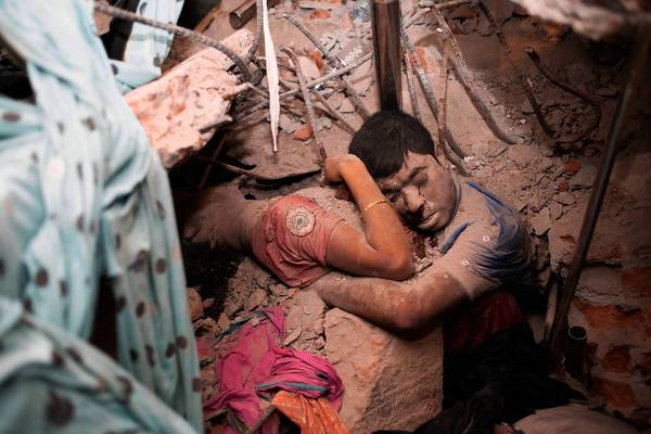 Time magazine called this image of two people who died in the April 24 fire and collapse of a garment factory in Bangladesh 'the most haunting photograph' from the tragedy.