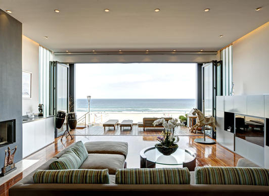 A custom folding door system allows the main living area to connect to deck space.