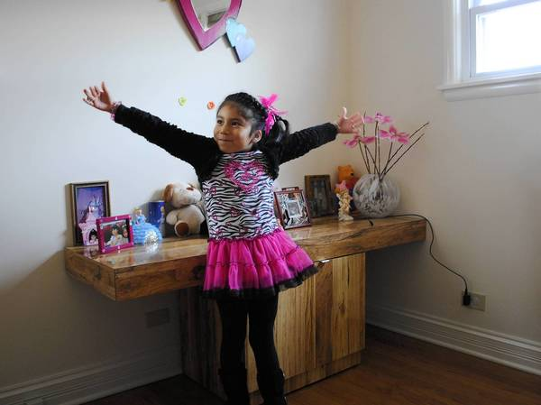 Daisy Rodriguez, 6, shows off how big her sister's bedroom is in their new Highland Park home. Until November, the family of four lived in a cramped one-bedroom apartment until they were able to purchase the one-story house through the city's affordable housing program.