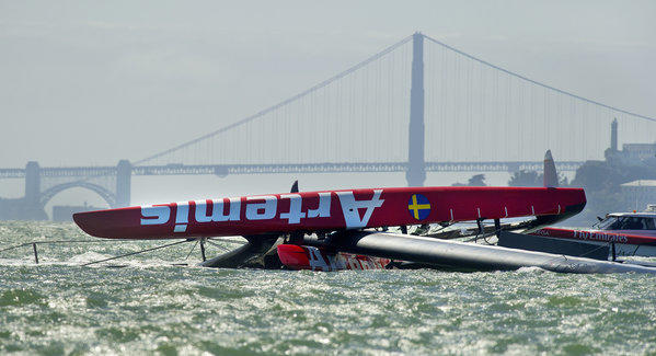 The Artemis Racing AC72 catamaran, an America's Cup entry from Sweden, lies capsized after overturning during training in San Francisco Bay.