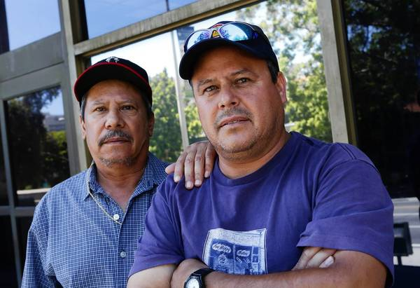 Brothers Jose I. Estrada, 58, left, and Jose A. Estrada, 48, are seeking class action status for their lawsuit against employer Harbor Express Inc.