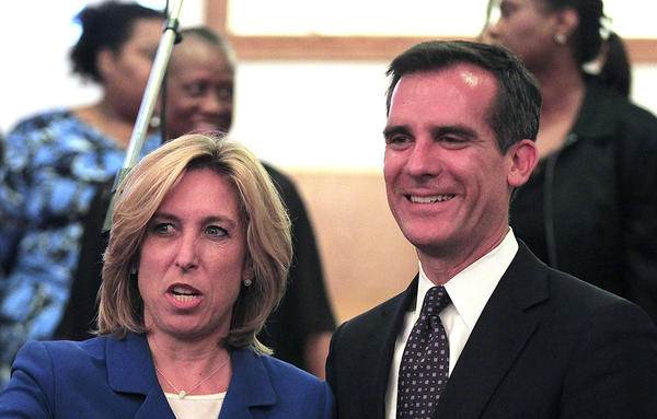 Mayoral candidates Wendy Gruel, left, and Eric Garcetti , right, following their candidates forum at Macedonia Baptist Church.
