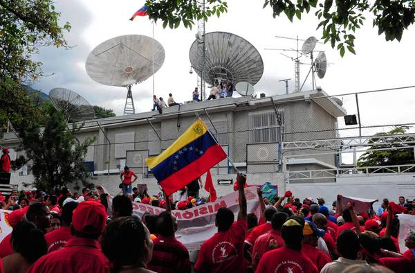 Supporters of then-President Hugo Chavez demonstrate outside Globovision in Caracas, Venezuela, in 2010. Since June 2007, Globovision has been the only major TV station with antigovernment editorial views.