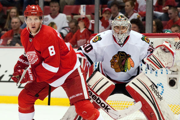 Red Wings forward Justin Abdelkader and Hawks goalie Corey Crawford will see a lot of each other in the next two weeks.