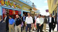 SEASIDE HEIGHTS — Britain's Prince Harry toured the rebuilding efforts underway at the Jersey Shore on Tuesday amid crowds gathered for a glimpse of the young royal, and to say goodbye to a popular roller coaster - a symbol of Superstorm Sandy's destruction.