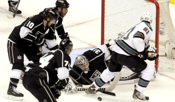 Jonathan Quick turns away a shot from TJ Galiardi during the first period of the Kings' second-round playoff matchup with the San Jose Sharks on Tuesday.