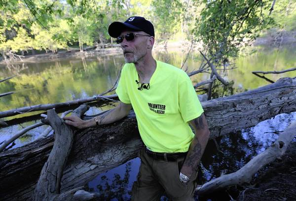 Robert Larson, a K-9 trainer in Westchester, discovered the body Tuesday near the Brookfield Zoo, after combing the Des Plaines River almost daily since April 17.
