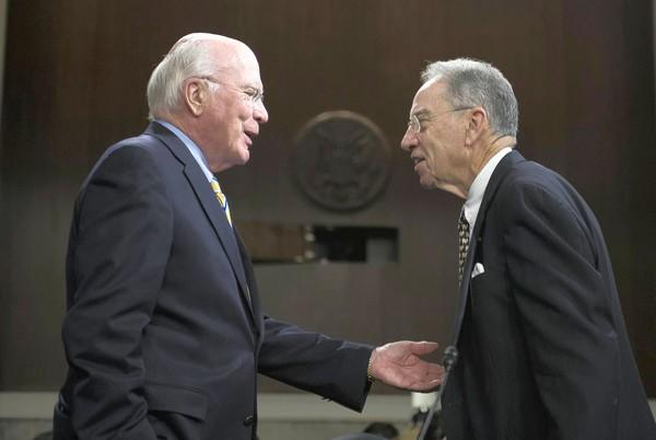 Sen. Patrick J. Leahy (D-Vt.), chairman of the Senate Judiciary Committee, meets with the panel's ranking Republican, Sen. Charles E. Grassley of Iowa, before Tuesday's hearing on the immigration reform bill. Grassley's amendment on student visa requirements was adopted by the committee.