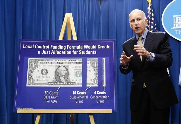 Gov. Jerry Brown answers a question about his education funding plan at a news conference in Sacramento.