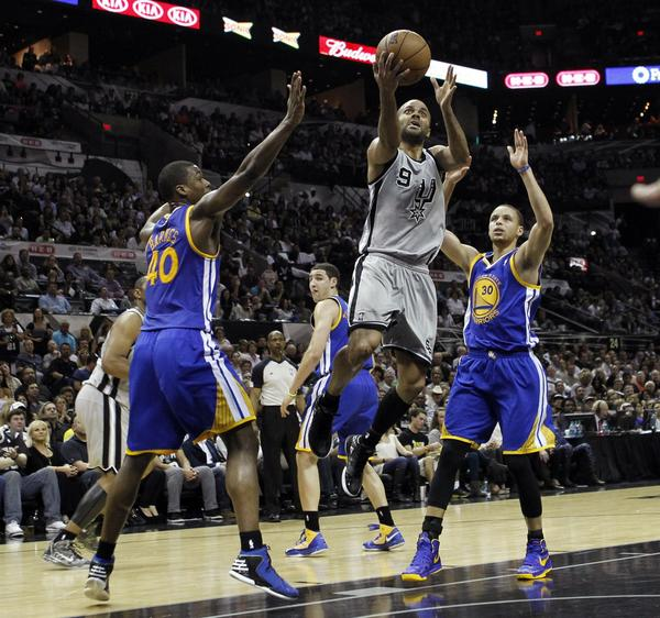Spurs guard Tony Parker drives on Warriors forward Harrison Barnes and guard Stephen Curry.