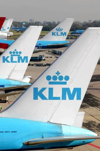 Passenger planes of the airline KLM at the airport Schiphol in Amsterdam.