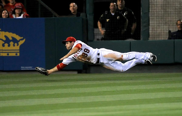Angels' J.B. Schuck makes a diving catch in the fourth inning against the Kansas City Royals.