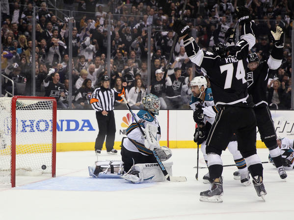 Dwight King of the Kings celebrates a goal as Sharks goalie Antti Niemi looks on.