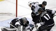 (Reuters) - Jonathan Quick stonewalled the San Jose Sharks with a 35-save shutout as the streaking Los Angeles Kings grabbed a 2-0 win in the opener of their Western Conference semi-finals series on Tuesday.
