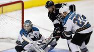 Sharks goalie Antti Niemi makes a 3rd period save on Kings Jeff Carter during Game 1
