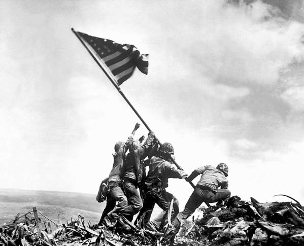 Ira Hayes (left), a Pima Indian from Arizona, was among five Marines and a Navy corpsman who raised an American flag at Mount Suribachi during the Battle of Iwo Jima in World War II. Hayes is buried at Arlington National Cemetery.