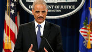 WASHINGTON (Reuters) - U.S. Attorney General Eric Holder said on Tuesday he had ordered the FBI to open a criminal probe in a growing scandal over the Internal Revenue Service's targeting of conservative political groups for extra tax scrutiny.