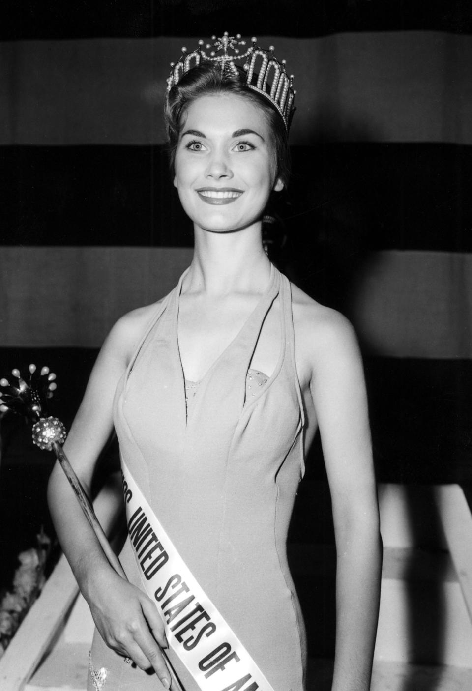 "Eurlyne Howell, Miss USA 1958, is captured for posterity in this picture from July 23, 1958, the night she became Miss USA.  Part of the original caption on this photo by the Associated Press read, ""She is 18 and a sophomore at Centenary College in Louisiana.  The new American bearuty will face 34 foreign entrants in the Miss Universe judging beginning the following night."".The original caption on this photo of Eurlyene Howell, Miss USA 1958, read, ""Slender Eurlyne Howell, a Louisiana honey blonde who discribes herself as a Southern Lady, wears her royal crown after being named the new Miss United States of America in the annual contest at Long Beach, CA July 23."""