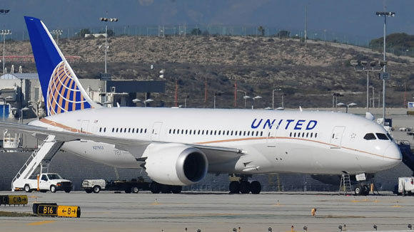 A United Airlines Boeing 787 Dreamliner on the runway at Los Angeles International Airport.