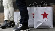 Macy's Inc. reported higher first-quarter net income and gains in a critical sales metric as it took business from rival department store chains.