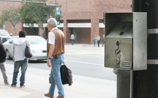 Glendale is considering a number of new smoking restrictions. Above, a cigarette collection box on Brand Boulevard in downtown.