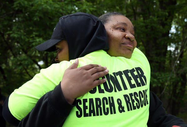 Brenda Lloyd, right, hugs search volunteer Betty Roberts at 1st Avenue and Lake Street in Maywood. Lloyd is the grandmother of 1-year-old Bryeon Hunter, who had been missing since April 15. Roberts was one of several volunteers who helped search for the boy's remains. The body of a child was found Tuesday on the Des Plaines River in Riverside, which is believed to be that of Bryeon.