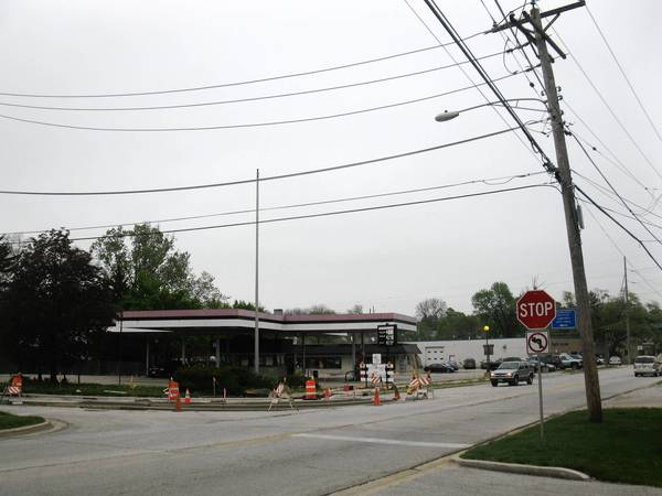 Under a proposal to build a roundabout in Warrenville, city officials would have to acquire a Phillips 66 service station owned by out-of-town investors.