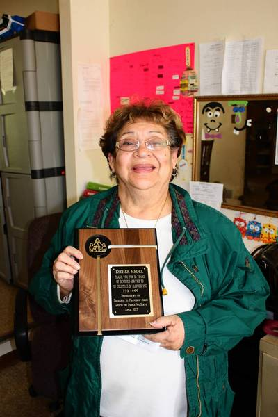 Esther Medell recently retired from Tinley Park-based St. Coletta's of Illinois Foundation after 38 years of service. Medel recently received a plaque from the foundation honoring her for her dedicated and compassionate service.
