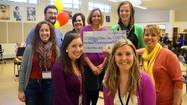 "A ""prize patrol"" appeared suddenly in a few Batavia classrooms this spring, bearing oversized checks and bunches of balloons."